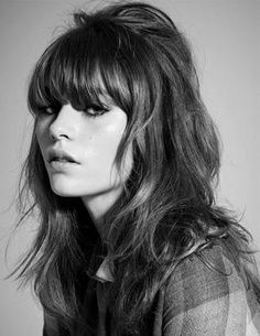 Shaggy layers & heavy bangs/60s vibe