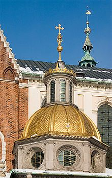 Octagonal drum, golden dome and lantern belongs to Sigismund Chapel.