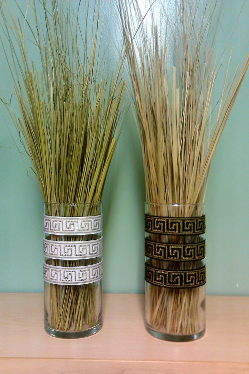 Cool idea for an Egyptian themed party! Spray glue decorative ribbon onto vases and fill with grasses.