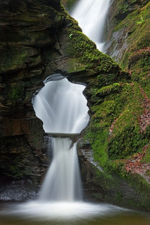 St Nectan's Kieve, Cornwall, England        The waterfall in St. Nectan's Glen has been described as one of the ten most spiritual sites in the country. It falls first into a kieve, orbasin (the Kieve is a potent symbol of Mother Earth and has long been a place of worship, reverence and healing since Celtic times). After the water leaps over a rock and into the kieve, it overflows and another waterfall carries the water to the lower level of the valley, where Condolden Barrow sits