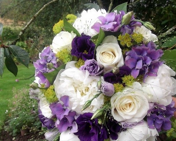 Avalanche roses, lilac and purple lisianthus bridesmaids bouquets