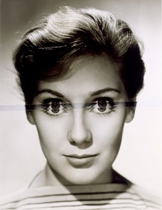 Photograph by John Stezaker. By making a very small change to the publicity image of this actress Stezaker suggests a more disturbing, less confident image. The additional strip in the area of the eyes also picks up the pattern stripes, at a slight angle, of the figure's clothing.