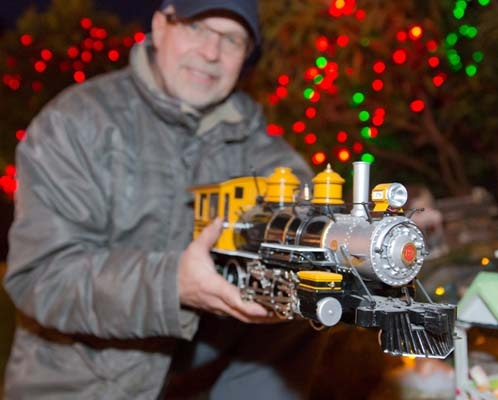 Tsawwassen's Benno Bucher has his festive model train display running again this year and is raising money for the Food on the Corner Society.