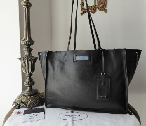 eac569a9a2a5 Prada Etiquette Tote in Black Glace Calfskin with Astral Blue Suede Lining  > https: