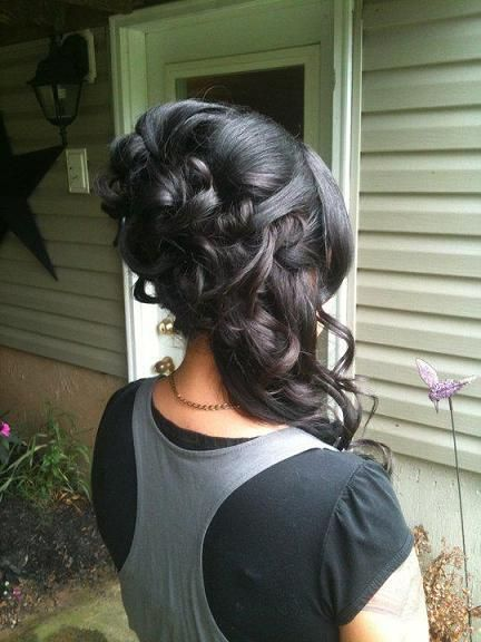 Wedding Hairstyle: Unique wedding hair, lots of curls, lots of hair pinned casually resting over shoulder.