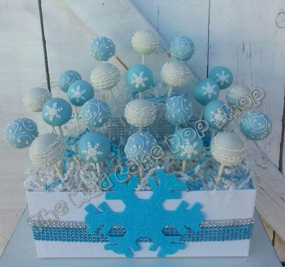 Presenting our adorable Tiffany Blue Swirl and White Dainty Spun cake pops. These make great Wedding favors or a great addition to a