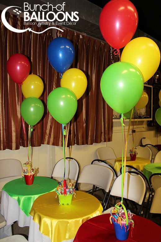 Balloon Centerpieces tied to small plant pots or other 'vessel' which is then filled with candy