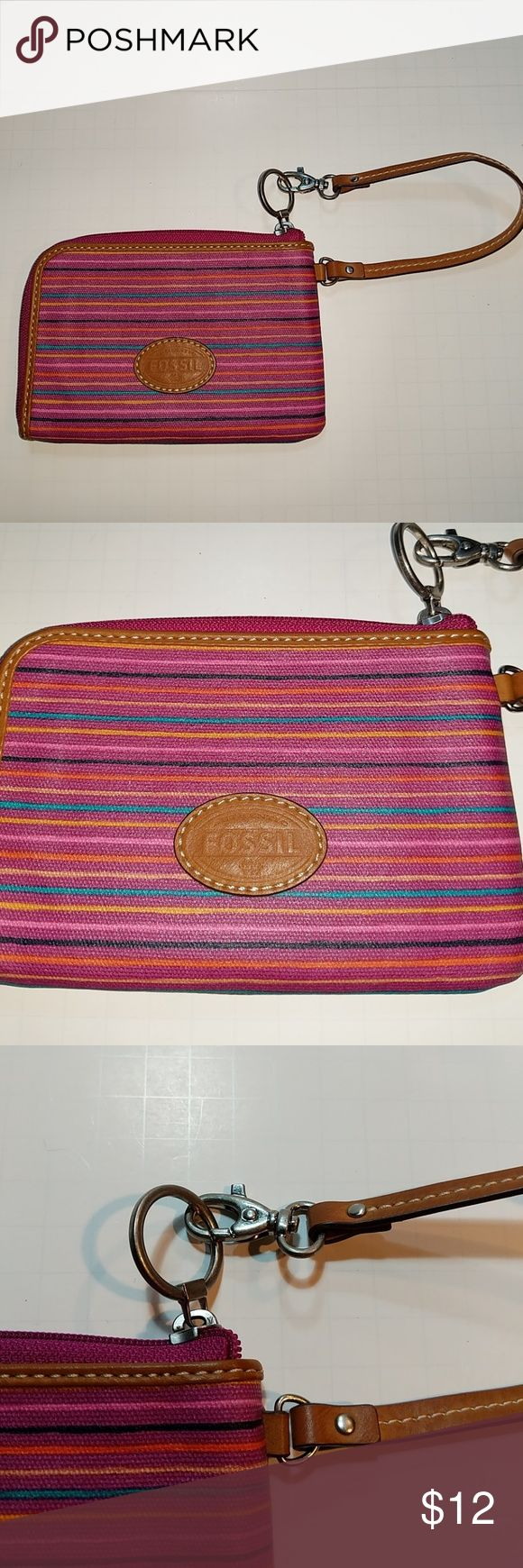Fossil dark mauve wristlet Like new fossil wristlet purples with black orange yellow and a teal stripe inside is a pink with credit card holders. Fossil Bags Clutches & Wristlets