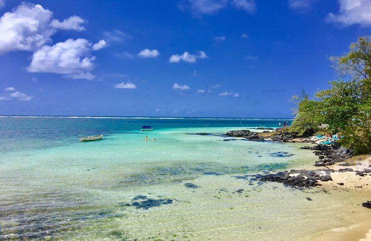 Island in heaven. Blue lagoon and white sand.