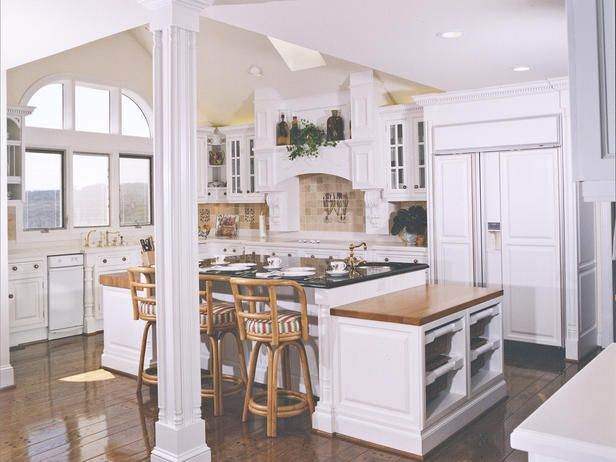 LOVE this kitchen. dark floors, white cabinets, bright windows. would ...
