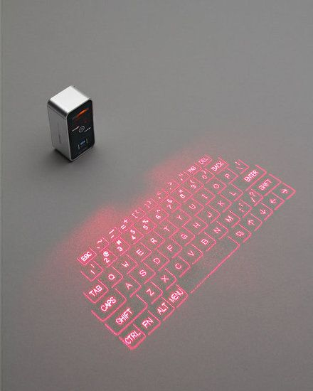 Magic Cube Keyboard: Chiclet desktop keyboard? How passé! Add a touch of wizardry to word processing when using the Magic Cube Keyboard ($150, originally $200), which uses laser beams to generate a working keyboard on most flat surfaces.