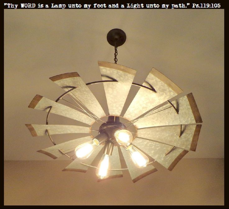 """Bold, Unique, Current & Dramatic! LampGoods' lead designer has done it again with this 4-light chandelier featuring an original, heavy galvanized windmill. * 30"""" wide and 9.5"""" tall. * Heavy Metal Wind"""