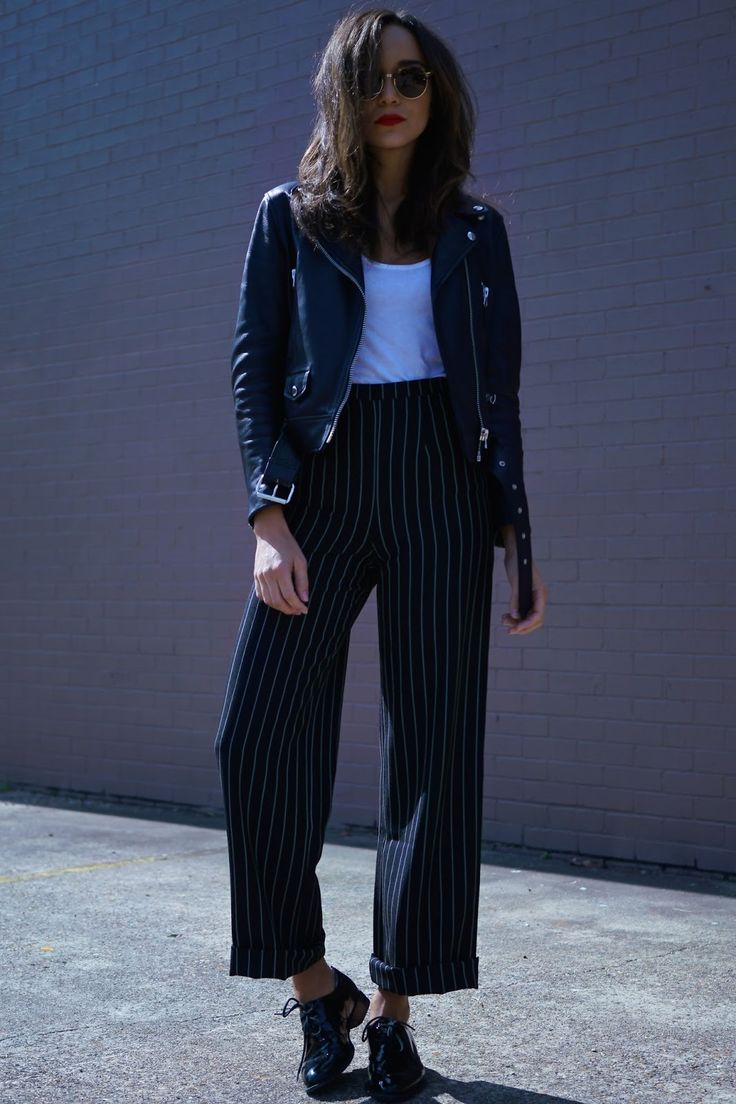 black leather jacket + white shirt + high-waisted pinstripe black navy and white striped cropped pants + shiny patent leather oxfords