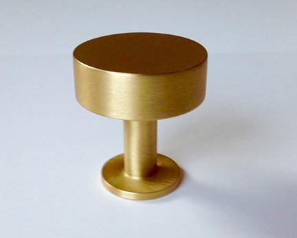 This Lew's Hardware Round Bar Knob is offered in a brushed brass finish. Collection: Lew's Hardware Round Bar Series Made of solid brass Simple geometric forms,