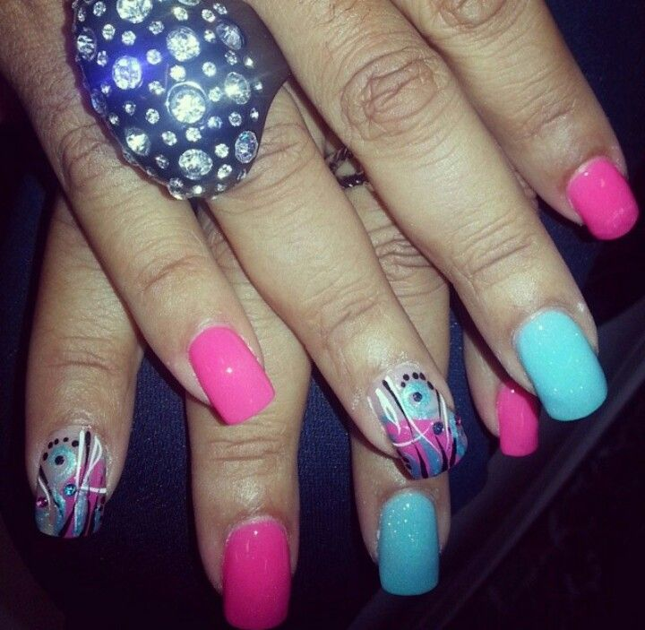 Pink and blue nails with contemporary designs