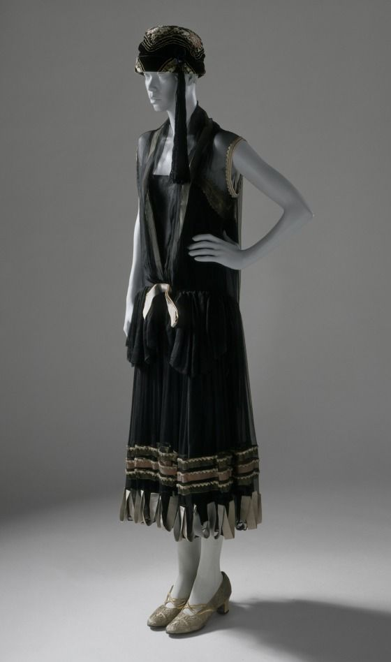 Circa 1924 Woman's silk chiffon trimmed with grosgrain and metallic ribbons and braid Dinner Dress by Paul Poiret, France. Via LACMA.