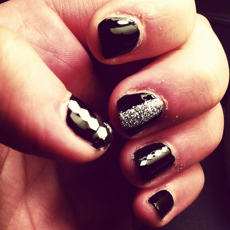 Black nails with silver polish and decals. Opi, essence, china glaze and joe fresh