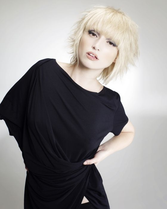 this cut is dope! heavy bangs + wispy messy chunky layers