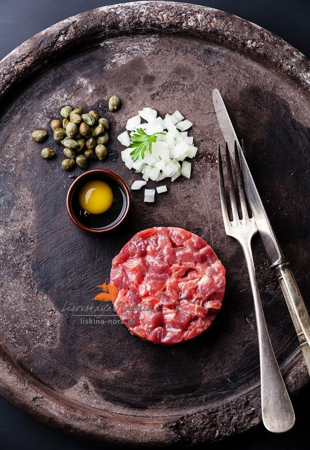 Beef tartar with capers and fresh onions on black textured background. Photograph тартар by Natalia Lisovskaya on 500px