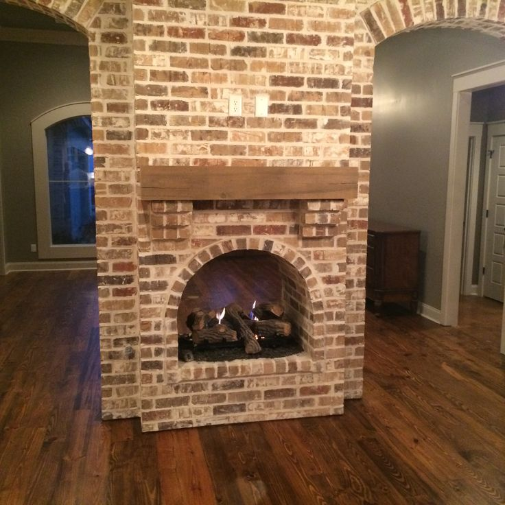 Double Fireplace With Exposed Interior Brick Arches