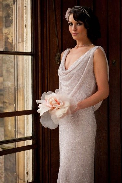 Tatiana, gownby Joyce Young in Scotland  This is style is exactly how I pictures my wedding dress with the swoop neck and back only i want mine in plain satin. No beads.