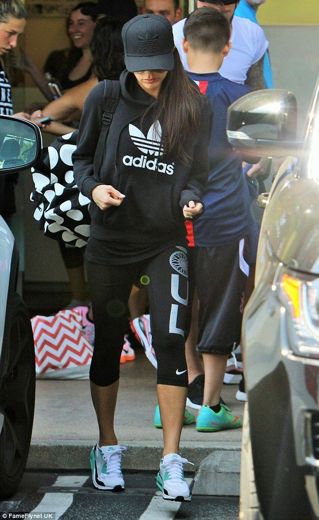 Not so Posh: Victoria Beckham cut an unusually casual figure - swapping her smart clothes for gym items - as she went to a Soul Cycle class with husband David in Brentwood on Saturday