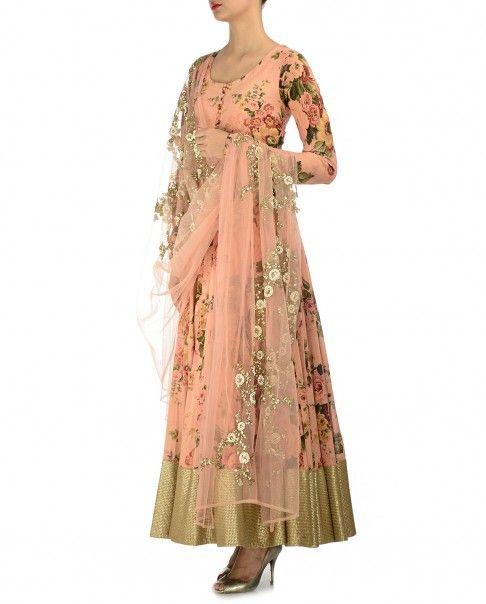 Salmon peach anarkali kurta with floral prints. Golden sequined hemline adorn the kurta. Scoop neck with loop button placket.