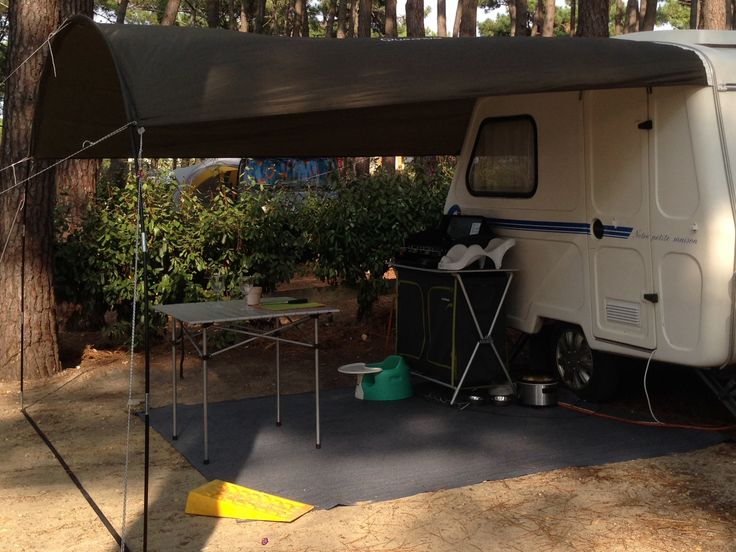 A modified Quechua tarpaulin makes for a perfect awning on our vintage Freedom Microlite caravan (1989)