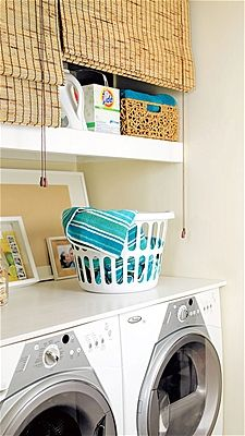 Organize your laundry room...have open shelves and dislike how it looks? Use window shades to conceal them.