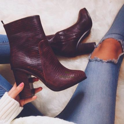 I have a pair of these chunky heeled booties, but in black leather!! love em!