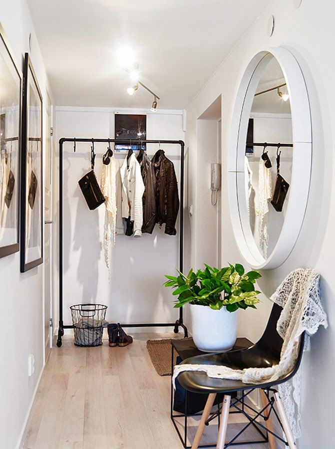 black and white. so simple. oversized artwork and mirrors in a small space.