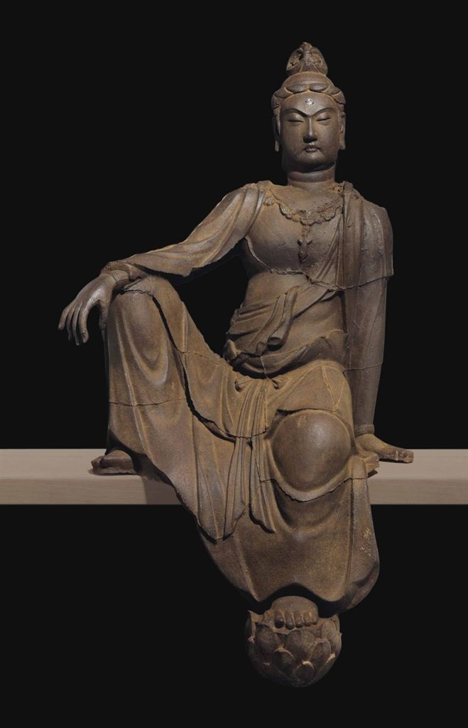 A VERY RARE LARGE AND IMPRESSIVE IRON MODEL OF GUANYIN - CHINA, YUAN-MING DYNASTY, 14TH-15TH CENTURY.