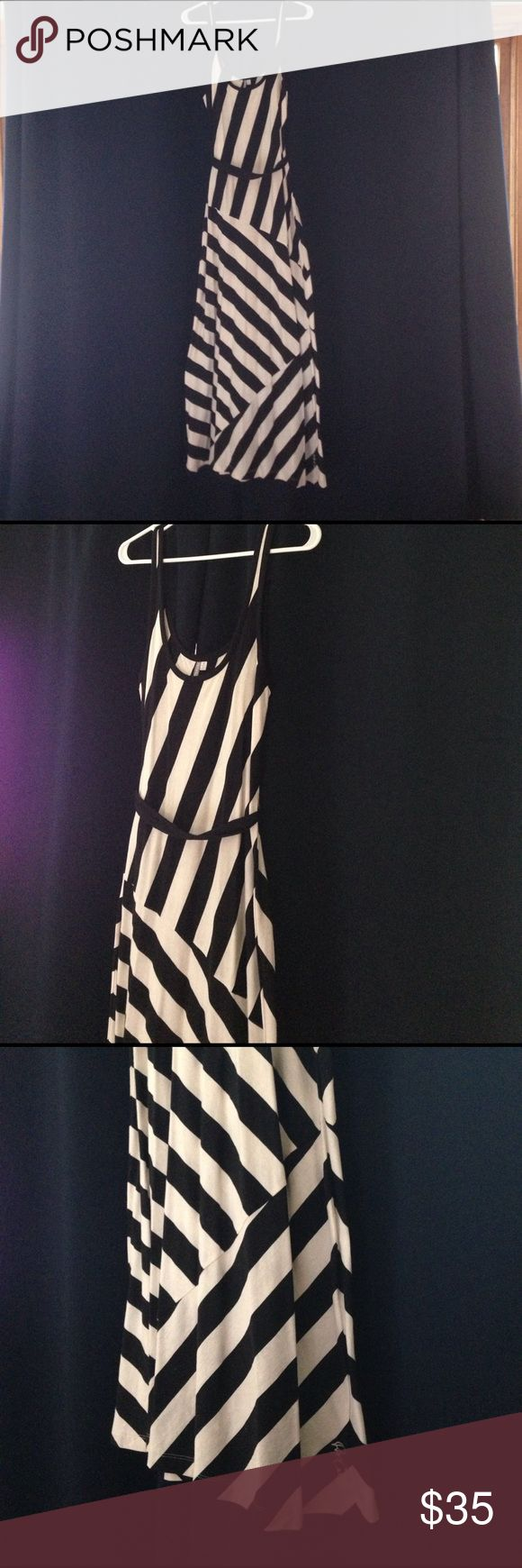 NWOT black and white maxi dress. Cute and comfortable black and white striped maxi dress. Tie belt. 60% cotton 40% polyester. Rip Curl Dresses Maxi