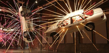 17th biennale of Sydney - China's Cai Guo-Qiang with an installation of nine cars frozen in mid explosion