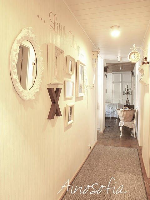 Tip - monochromatic scheme prevents wall decor from cutting into the visual space of a narrow hallway