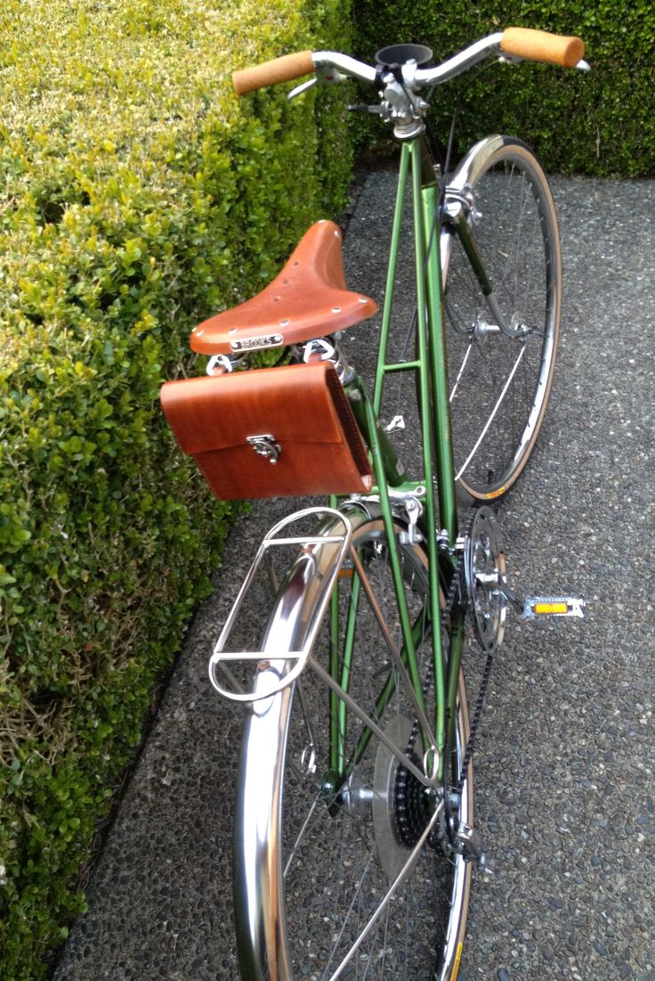 Vintage Motobecane Mixte bicycle restored by Ride Bicycles in Ravenna-Seattle, Wa. Bici Couture bag, Brooks Saddle, Velo Orange Fenders and rack, cork handle grips. This Mixte is cool, elegant, masculine! Hot! Hip! The list goes on! Gorgeous vintage bicycle!