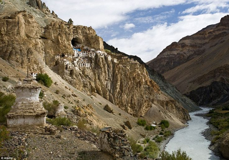 Giant honeycomb! The Phugtal Monastery in   India is hidden on a cliff on the entrance to a cave in the Zanskar region