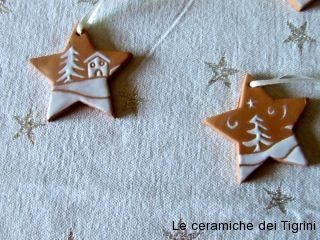 Decori di Natale in smalto bianco e cotto