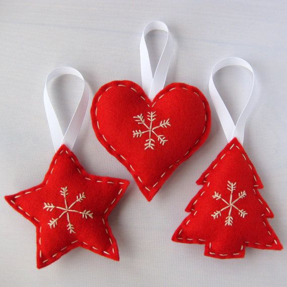 Scandinavian inspired, hand embroidered, red felt hanging Cmas decorations... hand embroidered with a snowflake motif in cream embroidery floss.  Lightly padded with polyester filling and finished with a white ribbon hanging loop.  approx 10cm square with a 7cm hanging loop.