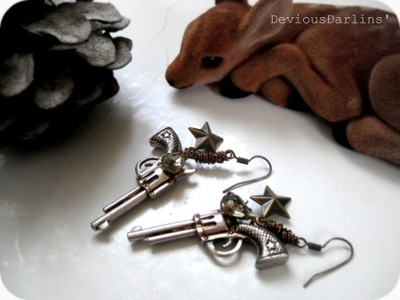 Lovely cowgirl revolver silver earrings, with brass stars and vintage rhinestones <3 From Devious Darlins'..