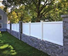 Universal Board Fence on Stone Wall | Wood, Solid Cellular PVC, Metal and Hollow Vinyl Fences from Walpole Woodworkers