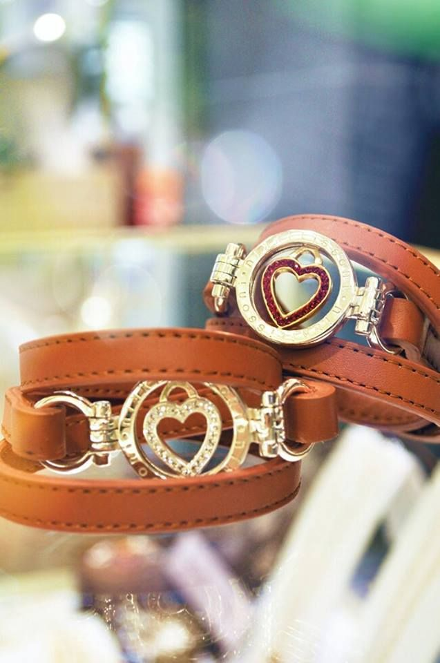 Light brown leather Nikki Lissoni bracelets...they are just filled with love!