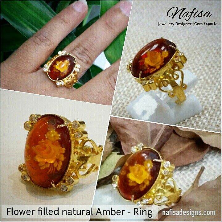 This technique of filling flowers in the center of Natural Amber (Kehrab) is ancient and very rare nowadays.  Amber, Design and making - Nafisa Designs. Kuwait