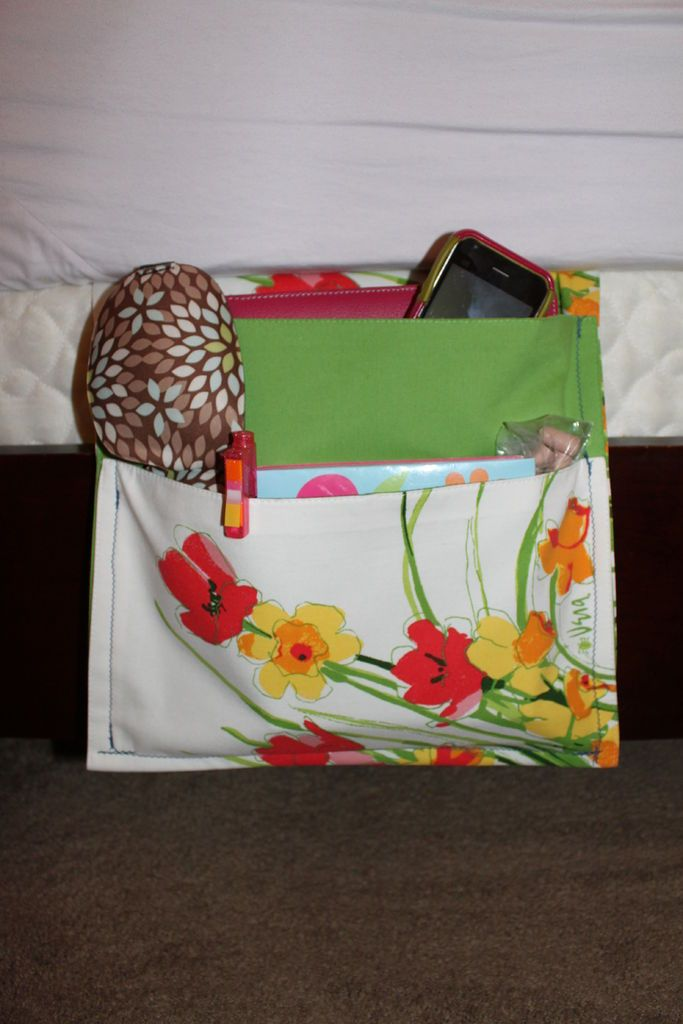 This is a great idea. Found it on this website when I was looking for a bedside caddy for four remotes. I don't like to sew, so I safety pinned the project all around and voila, a remote bedside caddy. My thanks to this very smart lady solskinner. Check this out. Also, the same general pattern makes a great tote for a walker. The part that fits under the bed can easily be pinned around the bar on a walker.
