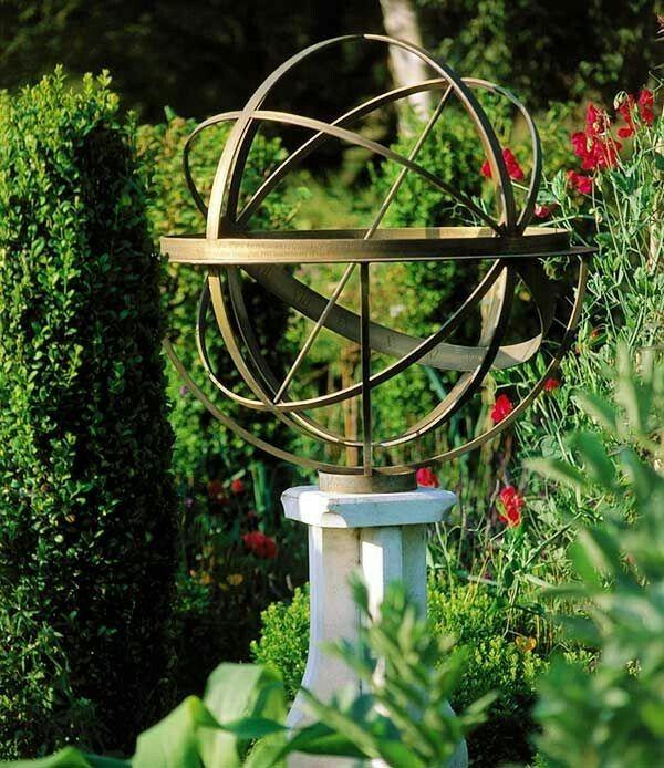 Brass Armillary Sphere In English Country Garden