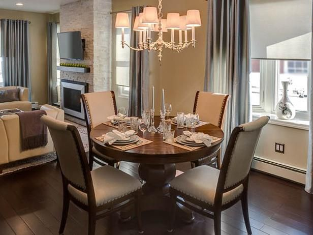 A Petite Round Dining Table Turns Half Of This Room Into Charming Area The Chandelier Helps Frame Out Space And Upholstered Chairs Bring