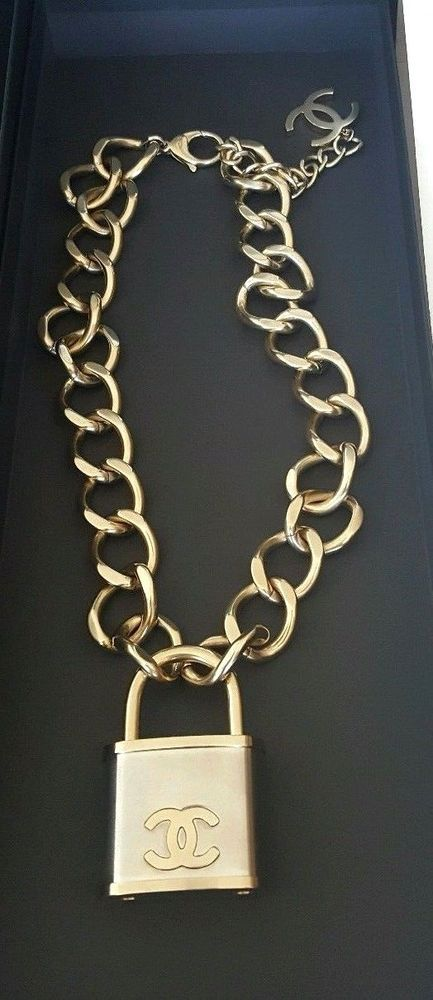 a5d3cbcf2557ac This is a oversized dull gold & silver metal padlock with golden CC and  smaller CC hanging on gold chain necklace. Comes in original black Chanel  box.