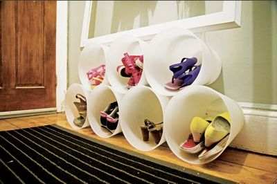 Dollar store trash cans used for shoe cubbies.  Could also be mounted higher on the wall as toy storage.  Love me some Dollar Store finds!