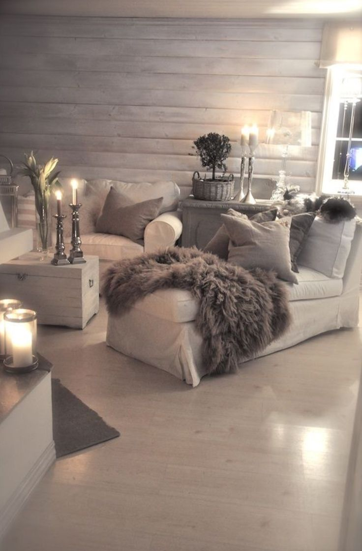 love the weathered ship lap, fur throw, tonal look,candles, couch