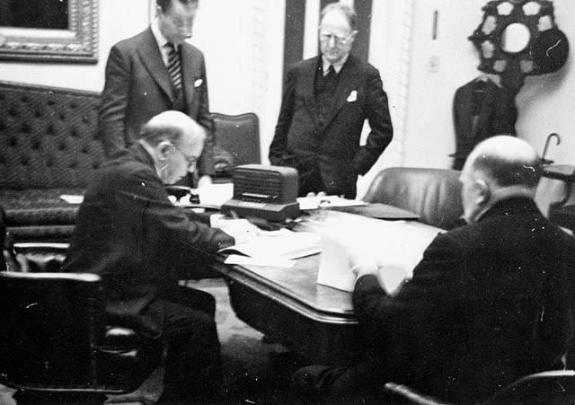 Rt. Hon. W.L. Mackenzie King... at the signing of the British Commonwealth Air Training Plan Agreement... / Le très honorable W.L. Mackenzie King... lors de la signature de l'accord sur le Plan d'entraînement aérien du Commonwealth britannique... | by BiblioArchives / LibraryArchives